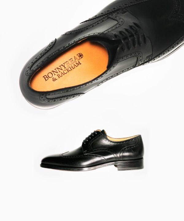 Zapato Cuero Negro Picado. 107,00 €, en tienda 215€