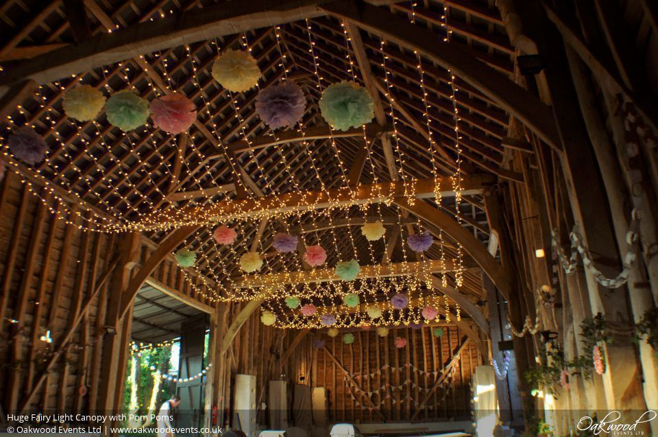 Huge Fairy Light Canopy with Pom Poms. Lighting by Oakwood Events. & Huge Fairy Light Canopy with Pom Poms. Lighting by Oakwood Events ...