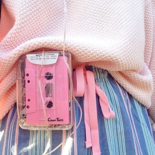 80s retro clear transparent portable cassette player with pastel pink tape