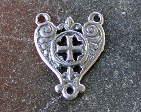 Two Sided This Rosary Center measures 11/16 x 1/2 (18mm x 14mm) and weighs 1.2 grams of Sterling Silver.  A very interesting rosary center, with a