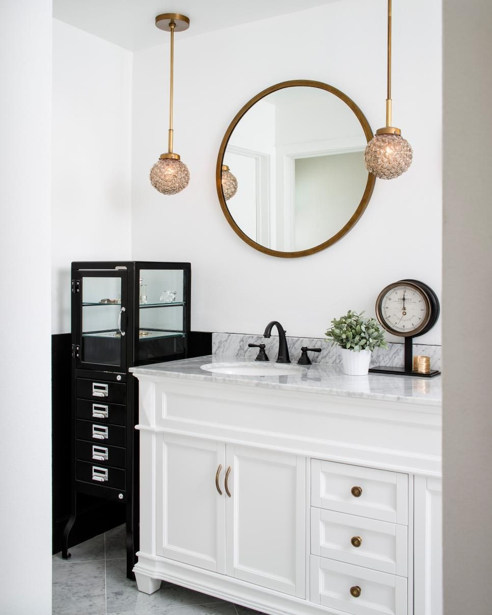 A black cabinet tucks perfectly into a niche beside the vanity to ...
