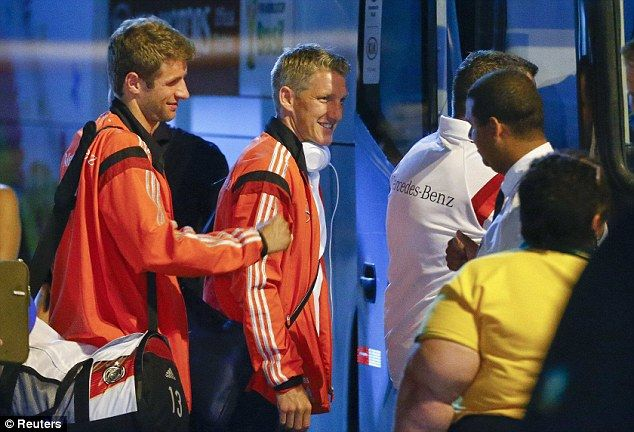 On the move: Muller (left) and Bastian Schweinsteiger get on their coach to travel during ...