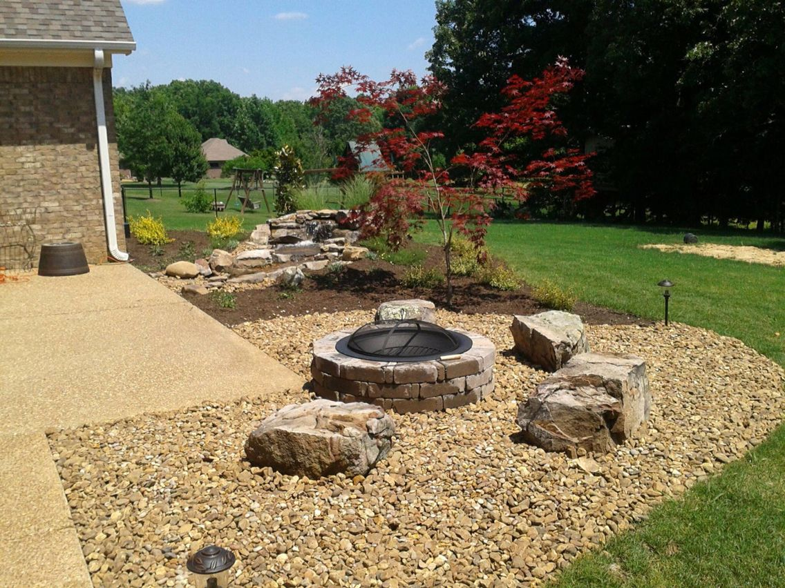 A Great Pondless Waterfall A Fire Pit With Boulder