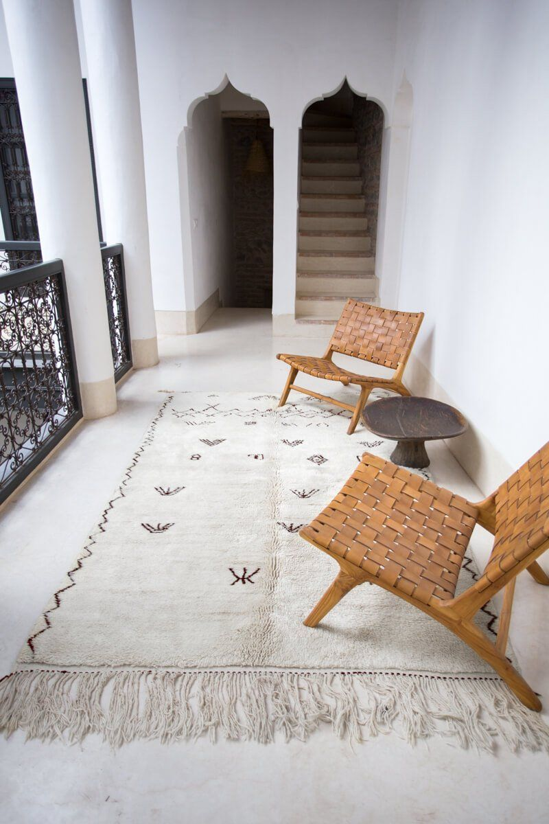 """Photo of """"Symbol"""" White Moroccan Berber Rug with Brown Tribal Symbols – 8'7″ x 5'2″"""