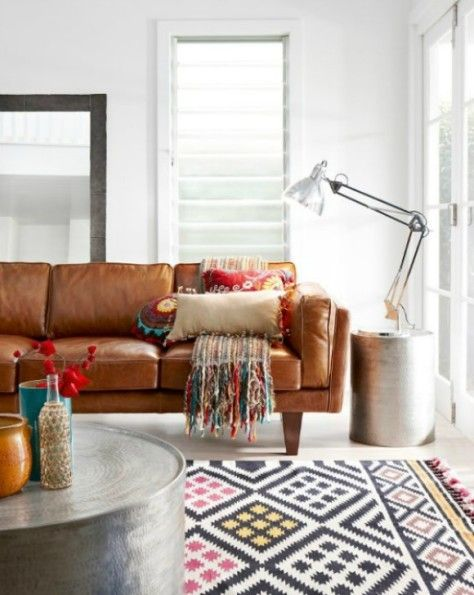 Living room with subtle boho pieces like this beautiful kilim rug