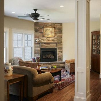 Classic room design with stone accent wall corner fireplace ...