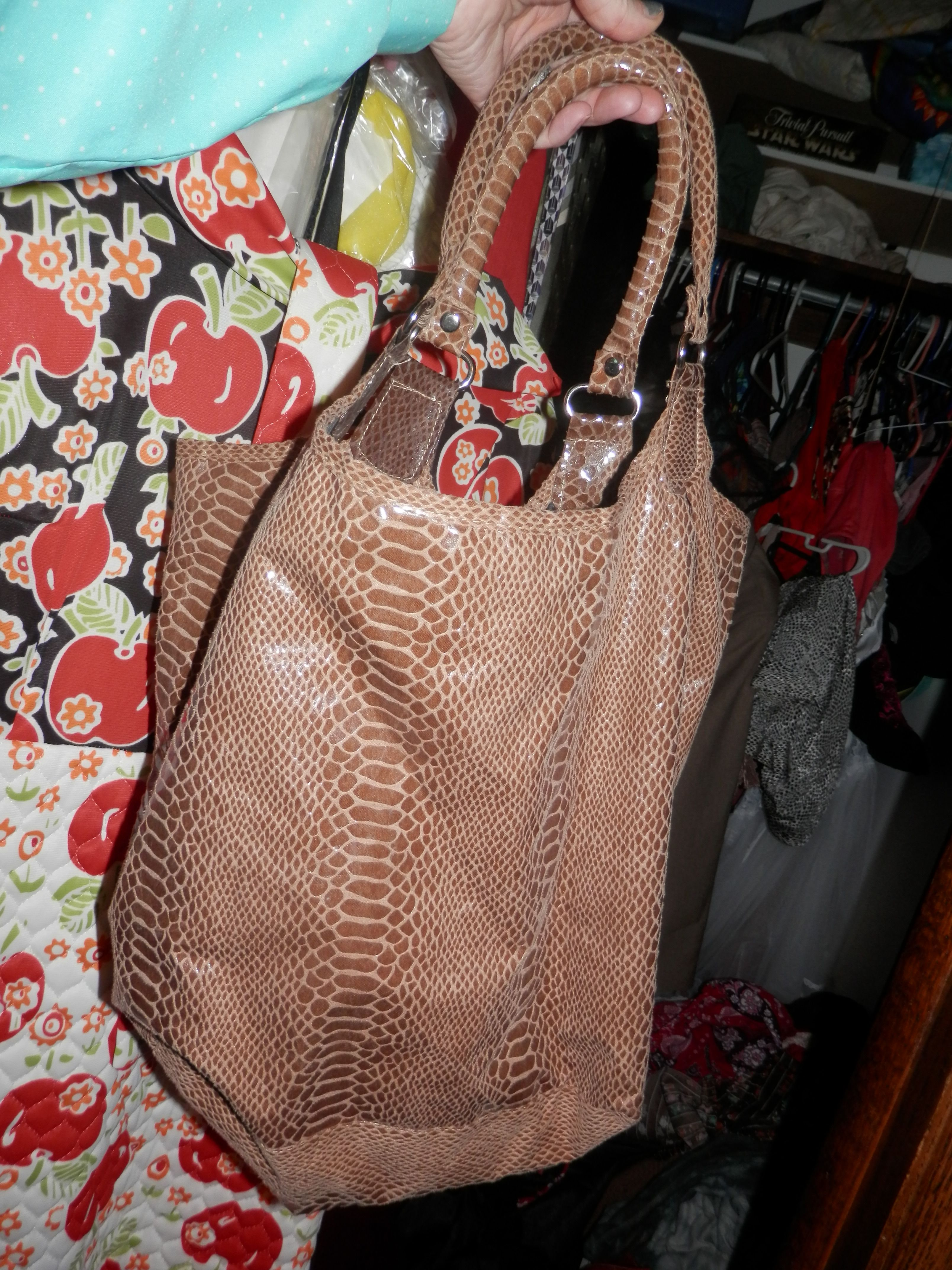 My snakeskin slouchy purse. Mine was free and is cuter than the expensive equivalent pictured b4 this photograph.