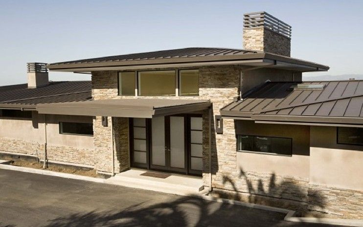 Stone siding and metal roof modern for the home for Modern homes with stone exterior