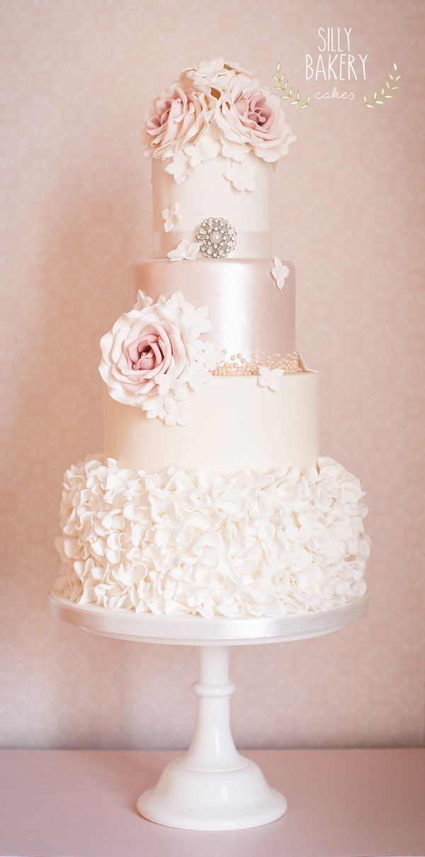vintage white ruffles and pink flowers wedding cake