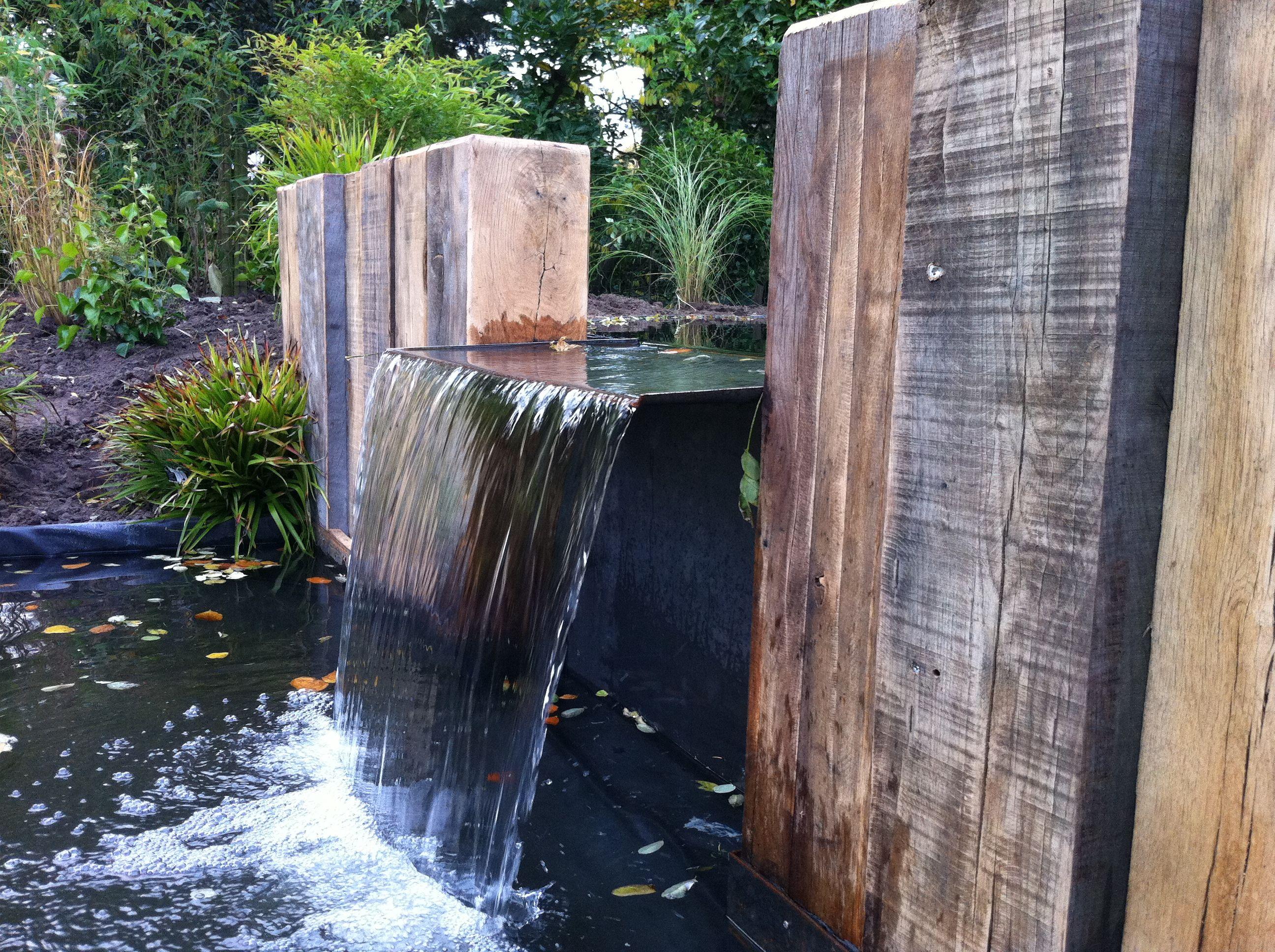 Tuinaanleg maken van een tuin met vijver en overkapping for Spiegelvijver maken