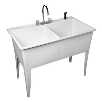 Double basin utility sink with spray nozzle. Laundry