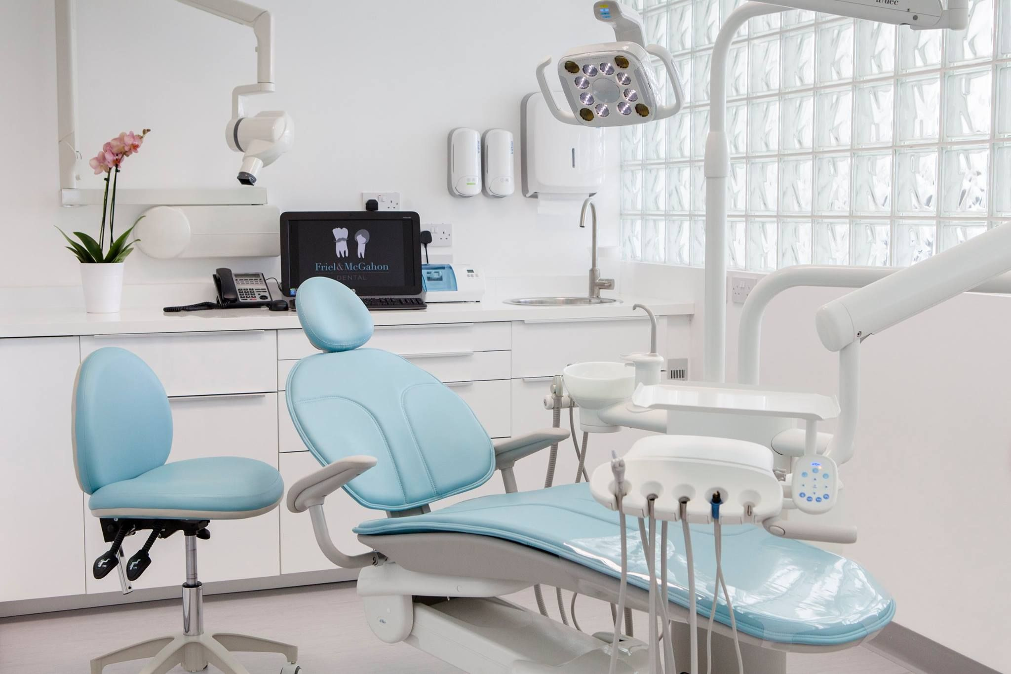 A dec 300 dental chair with Cyan sewn upholstery A dec LED light