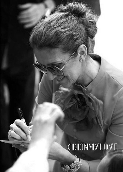 Céline giving autographs