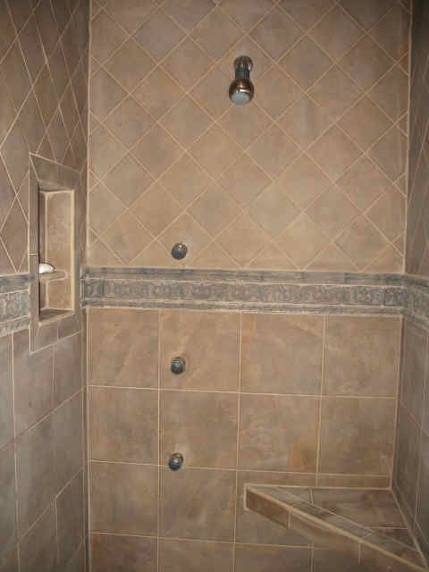 Porcelain tile shower with tile niche and bench - diagonal on top