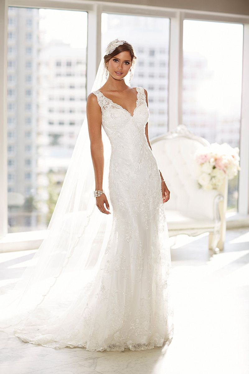 This vneck sheath wedding dress featuring satin lace and illusion