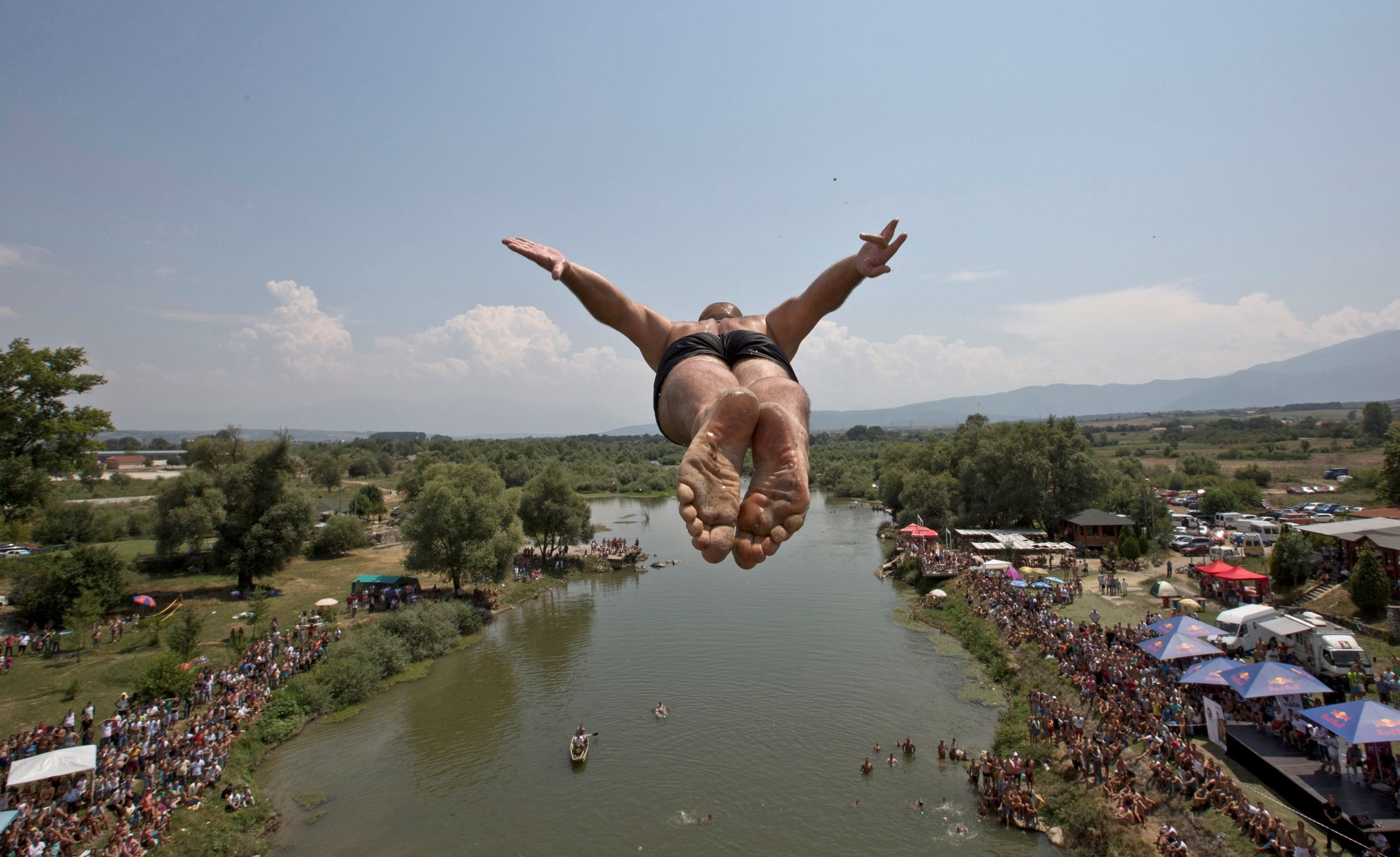 KOSOVO Spectators watch as a diver jumps from the Ura e
