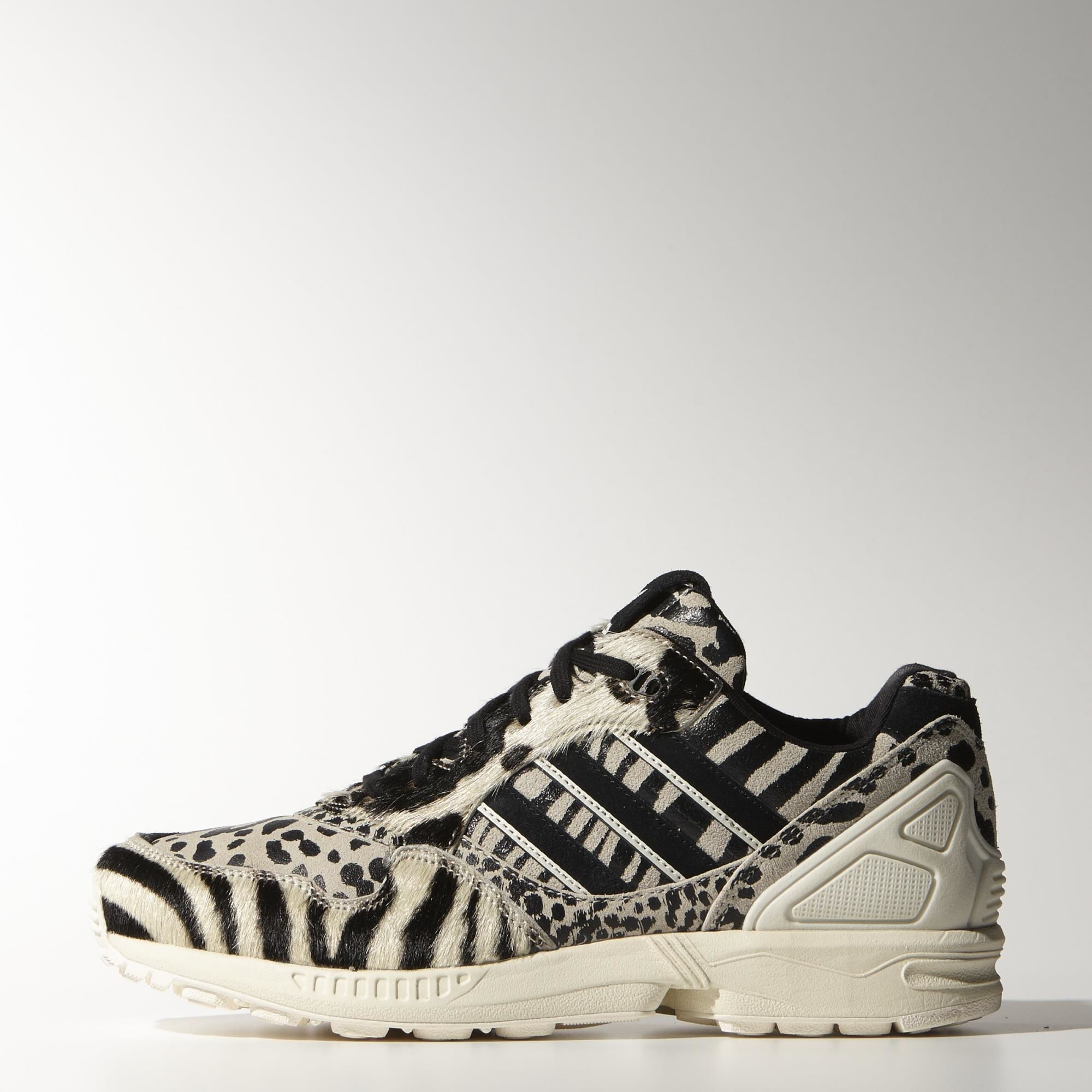d73c2a25e The retro style of the ZX runner goes on safari with a wild animal print on  the suede and pony-hair leather upper. These women s shoes feature suede a  ZX ...