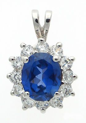 18 karat white gold cz round with synthetic oval blue stone 18 karat white gold cz round with synthetic oval blue stone pendant aloadofball Choice Image