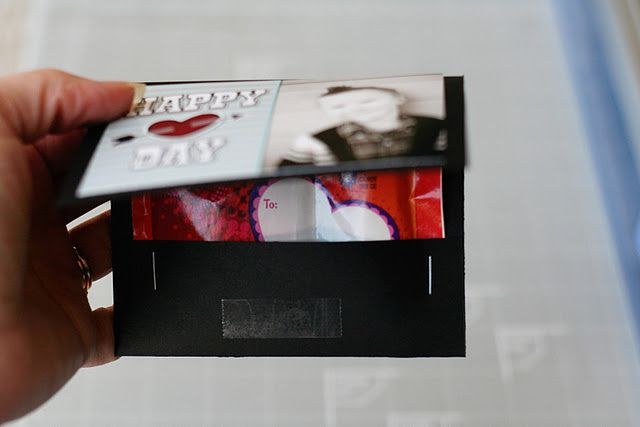 """Valentine's Day DIY craft. Matchbook Valentines.   what you'll need:        black cardstock      double sided tape (or other adhesive)      stapler      valentine fun dips    step one... Trim your cardstock to 4 1/2 x 8 1/2 inch strips. Then, with your paper horizontal, score it at the 3 1/2"""" and 7"""" marks.  step two... Attach your Valentine on the far left block, then fold at your score lines and insert the Fun Dip inside. Staple it in on both sides.  step three... Place a piece of double…"""