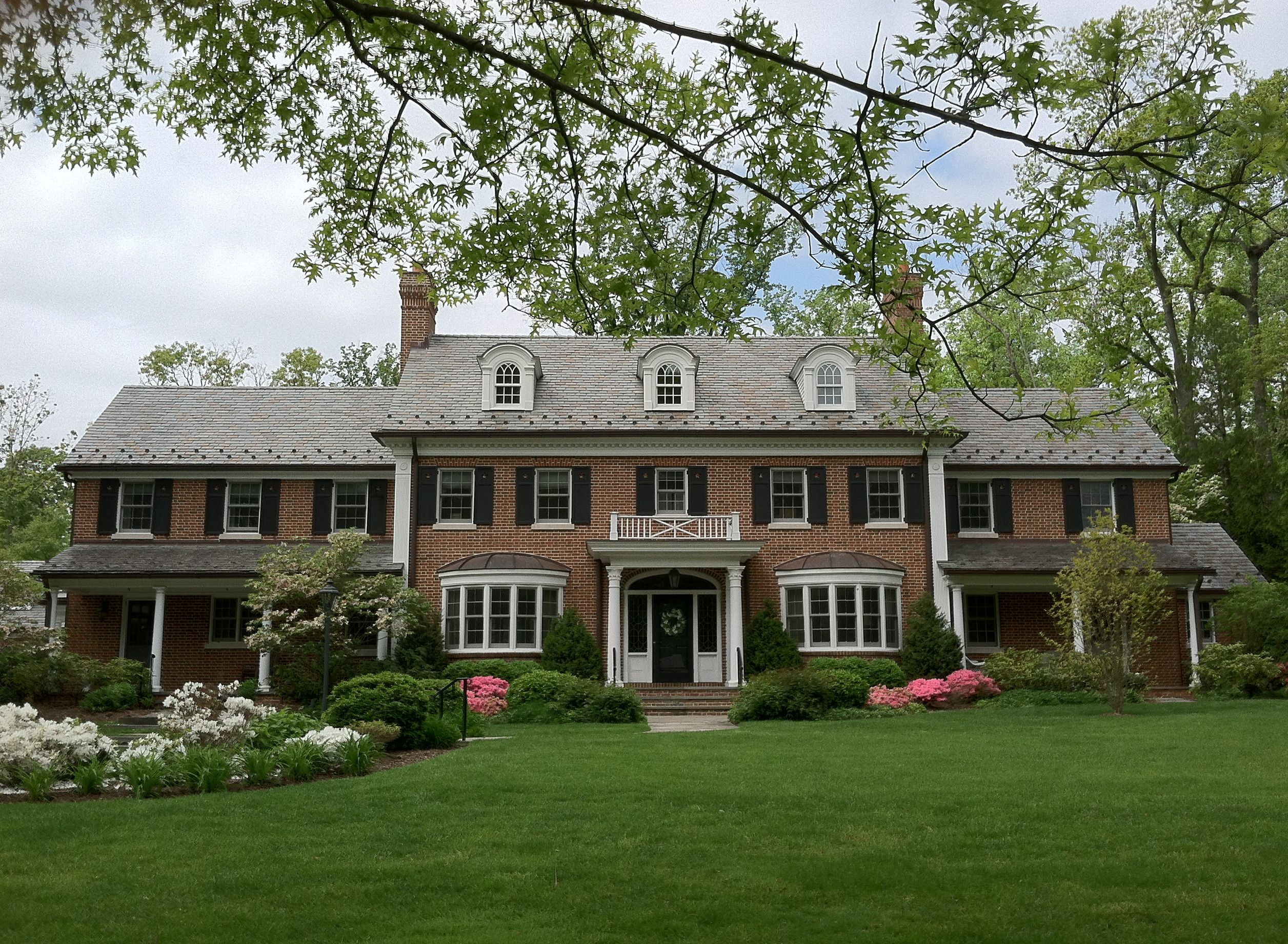 This Beautiful Traditional Red Brick Colonial Is A Large Expansive 6 000 Square Foot Home Accented Colonial House Exteriors Colonial Style Homes House Exterior