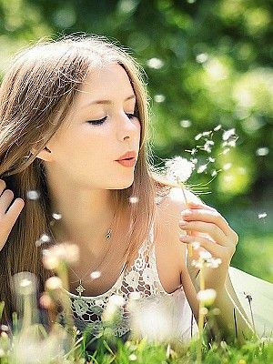 love the colors, her makeup, the dandelion, the lying down-looking away