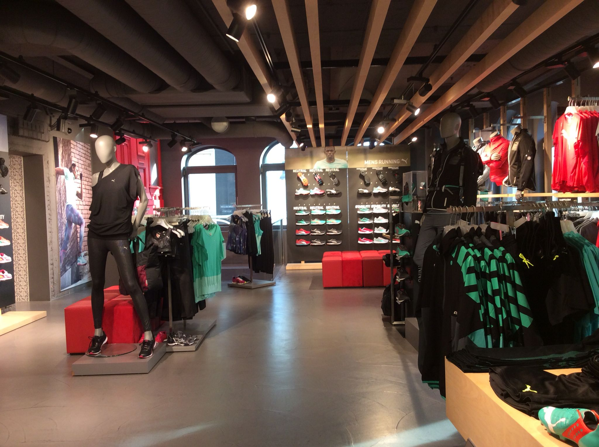Horizontal timber slats across the roof draws the eye to the shoes at the back of the store puma concept store amsterdam november 2014
