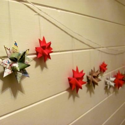 German paper stars from red paper, maps, and old sheet music.