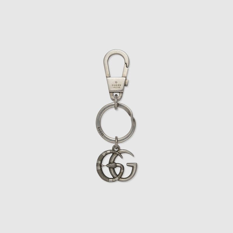 14de63302009 Shop the Double G with snake keychain by Gucci. The Double G emblem is  enriched with a Kingsnake motif