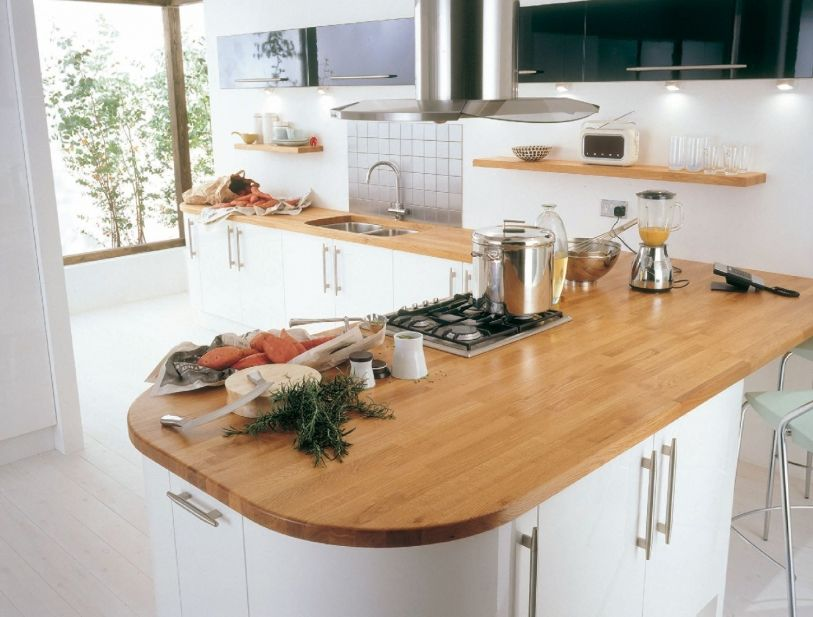 Trend gloss white kitchen with solid wood worktop. British made kitchens at  West London Kitchen Design