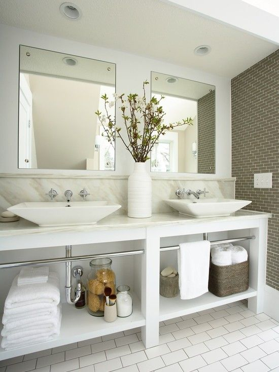 Open storage under a double vanity makes a master bathroom feel more  spacious and offers a handy spot for towels  A traditional marble top and  backsplash. Double sink  separate mirrors and gray backsplash    For the Home
