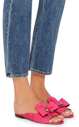 Crystals and a feminine bow adorn these hot pink **Oscar de la Renta** sandals.