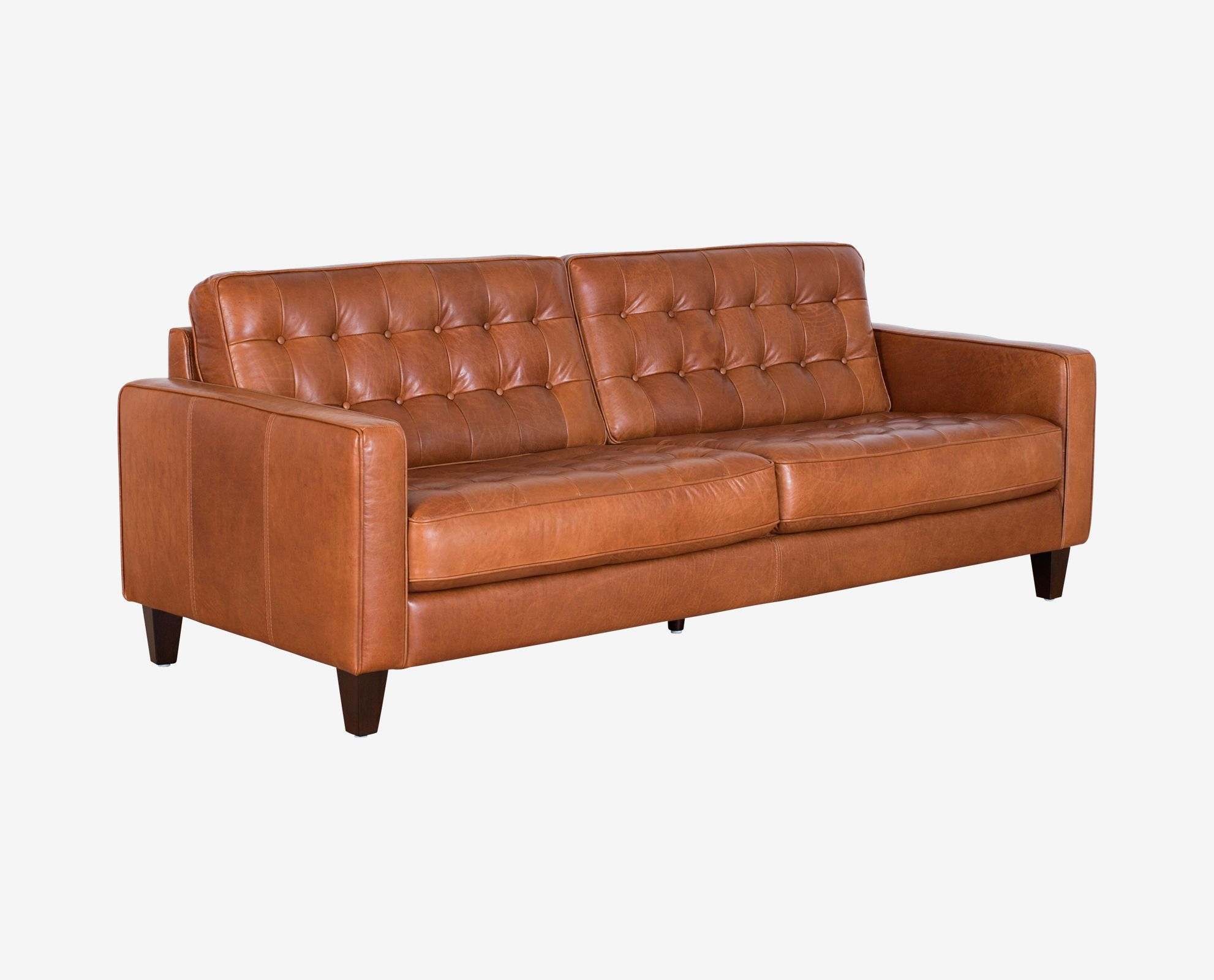 Scandinavian designs the gustav sofa features a button tufted design and deep comfortable cushions crafted from premium leather that highlights a range of