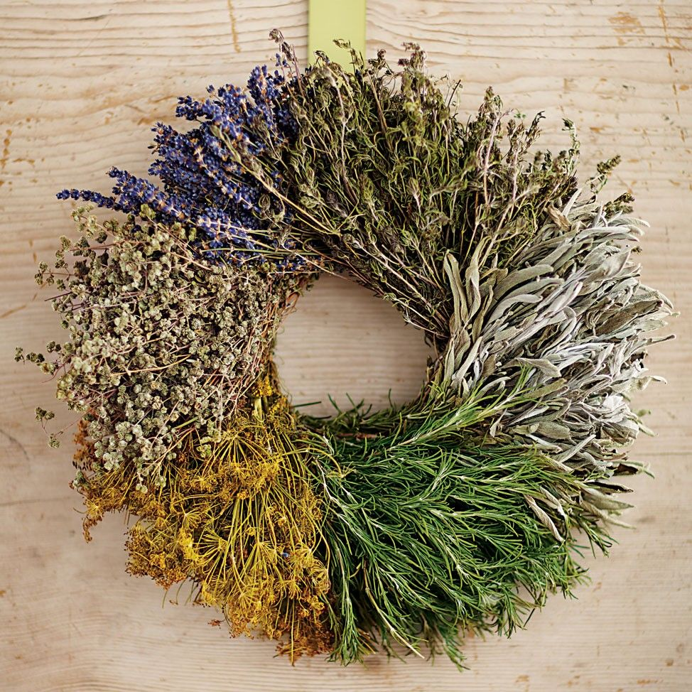 Handcrafted by artisans at a family-owned farm, this all-natural wreath combines fresh rosemary with dried savory, dill, marjoram, sage and lavender for a long-lasting kitchen accent.