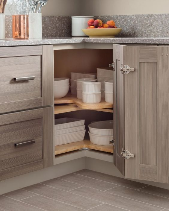 04 baking dishes stacked in a corner storage space shelterness corner kitchen cabinet on kitchen organization cabinet id=27674