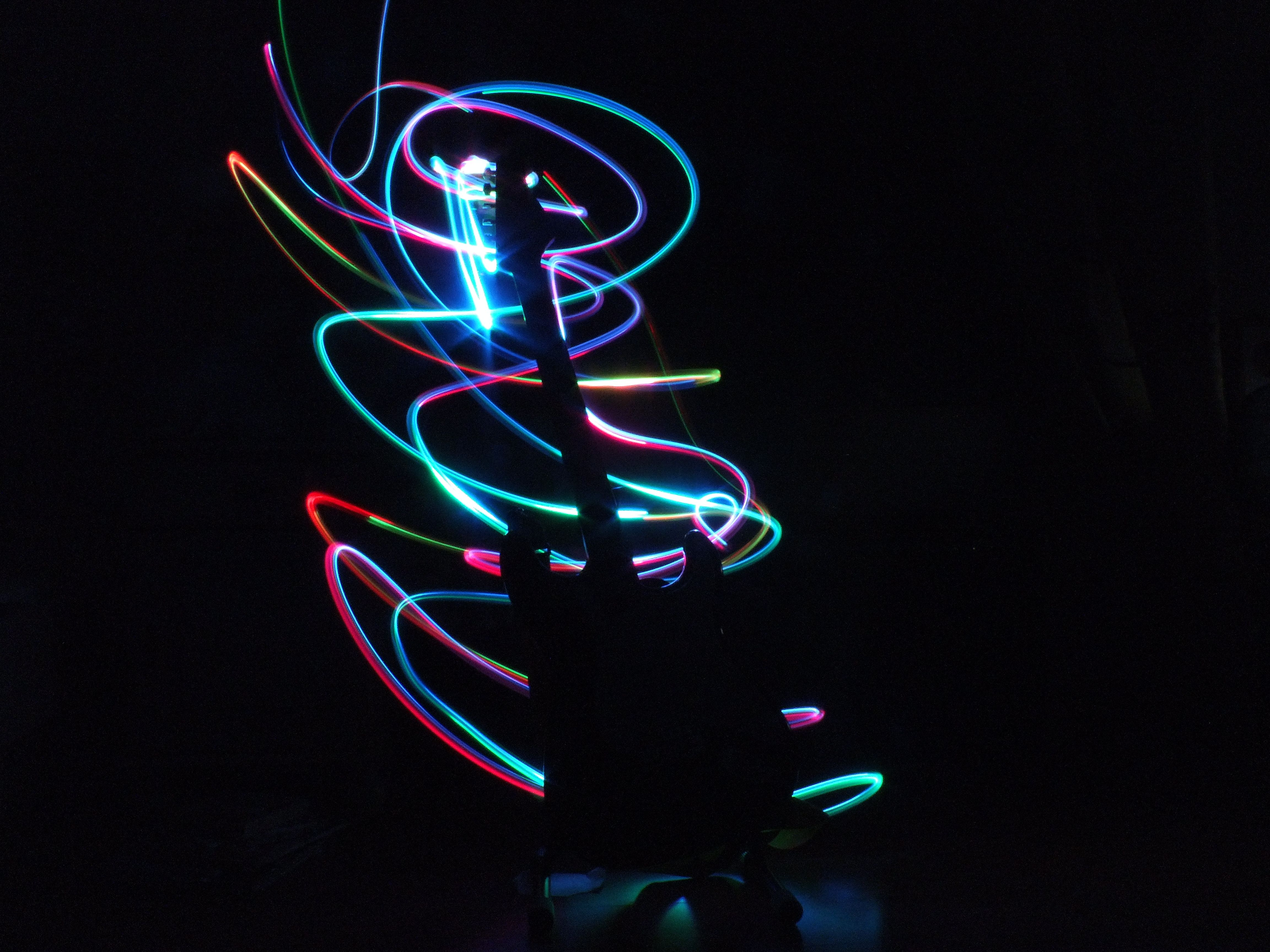 Guitar silhouette. Made with slow shutter time and a light changing its colours while I wave it around, and of course its done in a dark room.