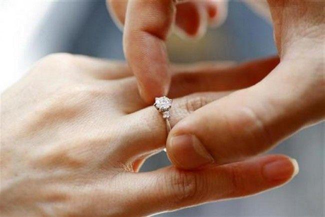 Diamond Engagement Rings On A Finger 8