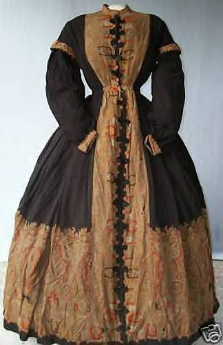 1863 wool dress with jet buttons with elastic loops.