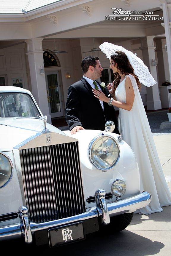 We Love How This Photo Shows Off The Classic Rolls Royce While Also Capturing A Sweet Momen Disney World Wedding Disney Fairy Tale Weddings Classic Car Wedding