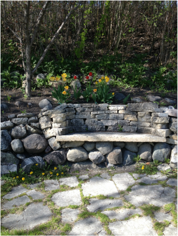 stone garden bench - contemplative spot at Maple Grove on shore of Red River in St Andrews MB Canada