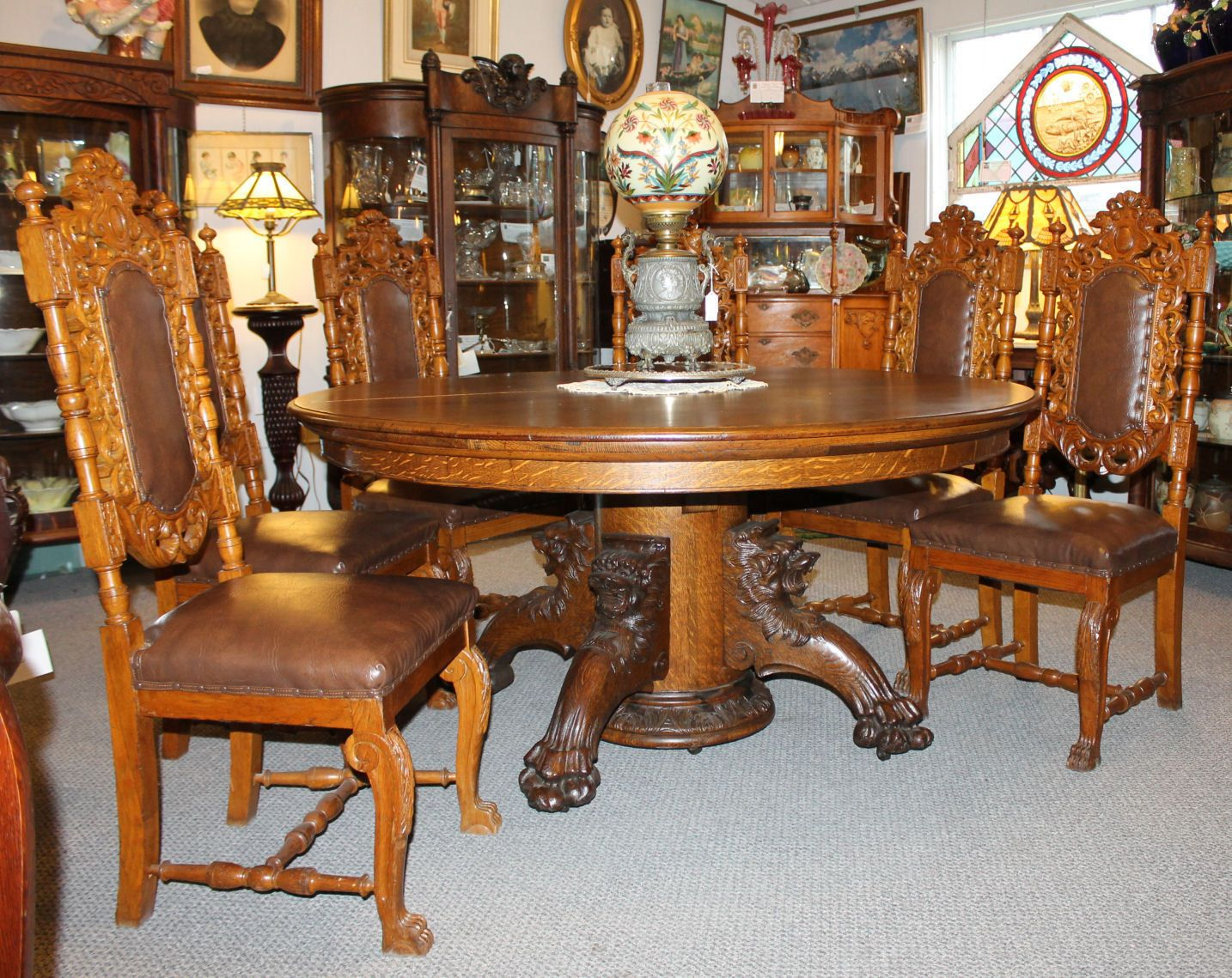 Antique Round Oak Dining Table With Carved Lion Headed And