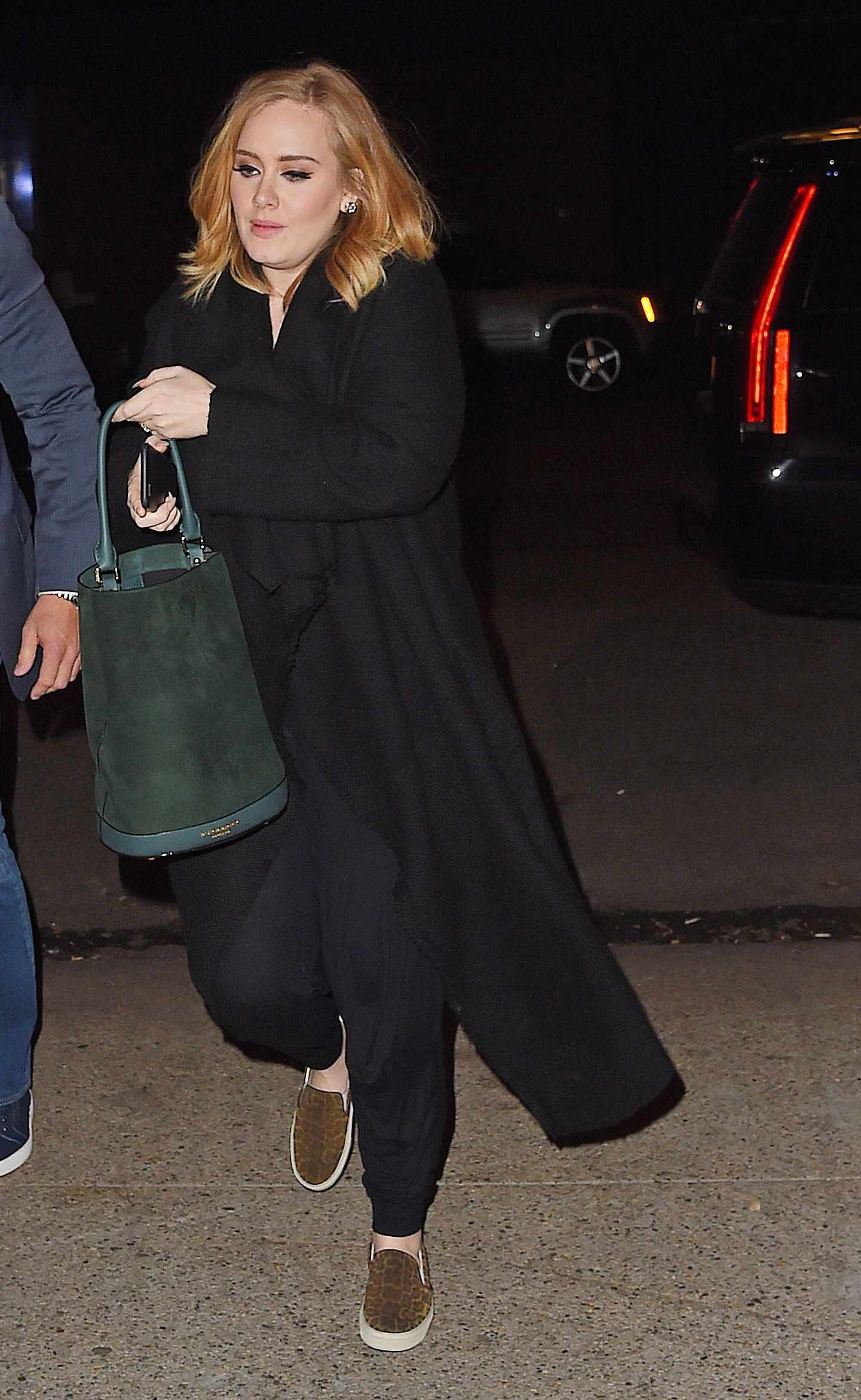 Adele wearing the @Burberry Bucket Bag . Photo © by Burberry