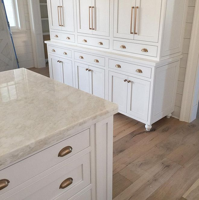 White Kitchen Hardware white kitchen cabinets with light hardwood floors and brass