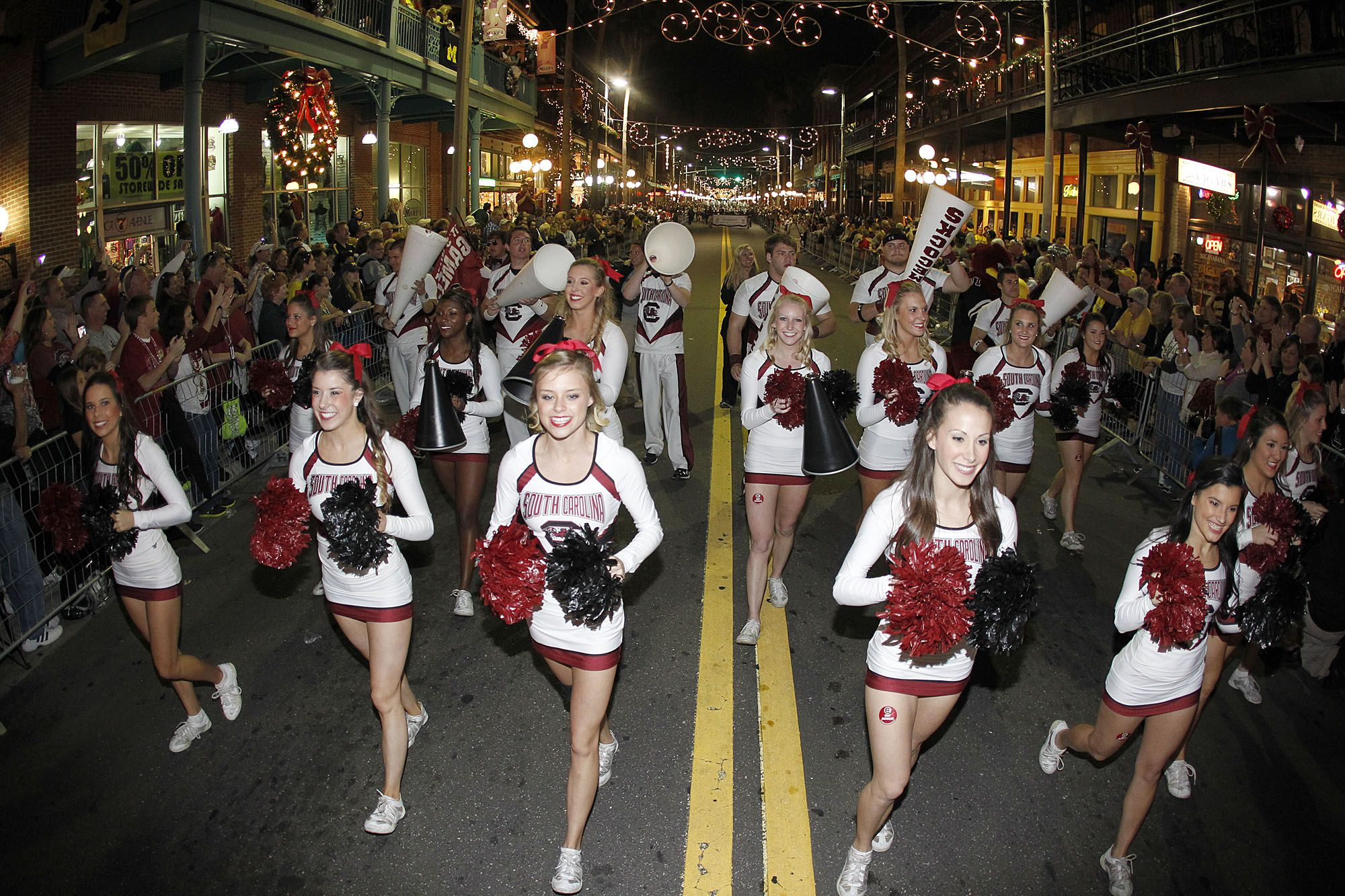 Gamecock cheerleaders and marching band at the Outback