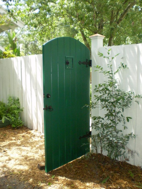 Arched gate with speak easy door | Fences and Gates | Pinterest