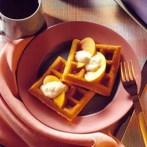 For breakfast or brunch, serve fresh fruit and yogurt to top these dense waffles.
