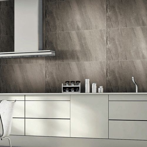 Graphite Grey Volcanic Ash Effect Tiles Used On The Wall Of A Modern Kitchen