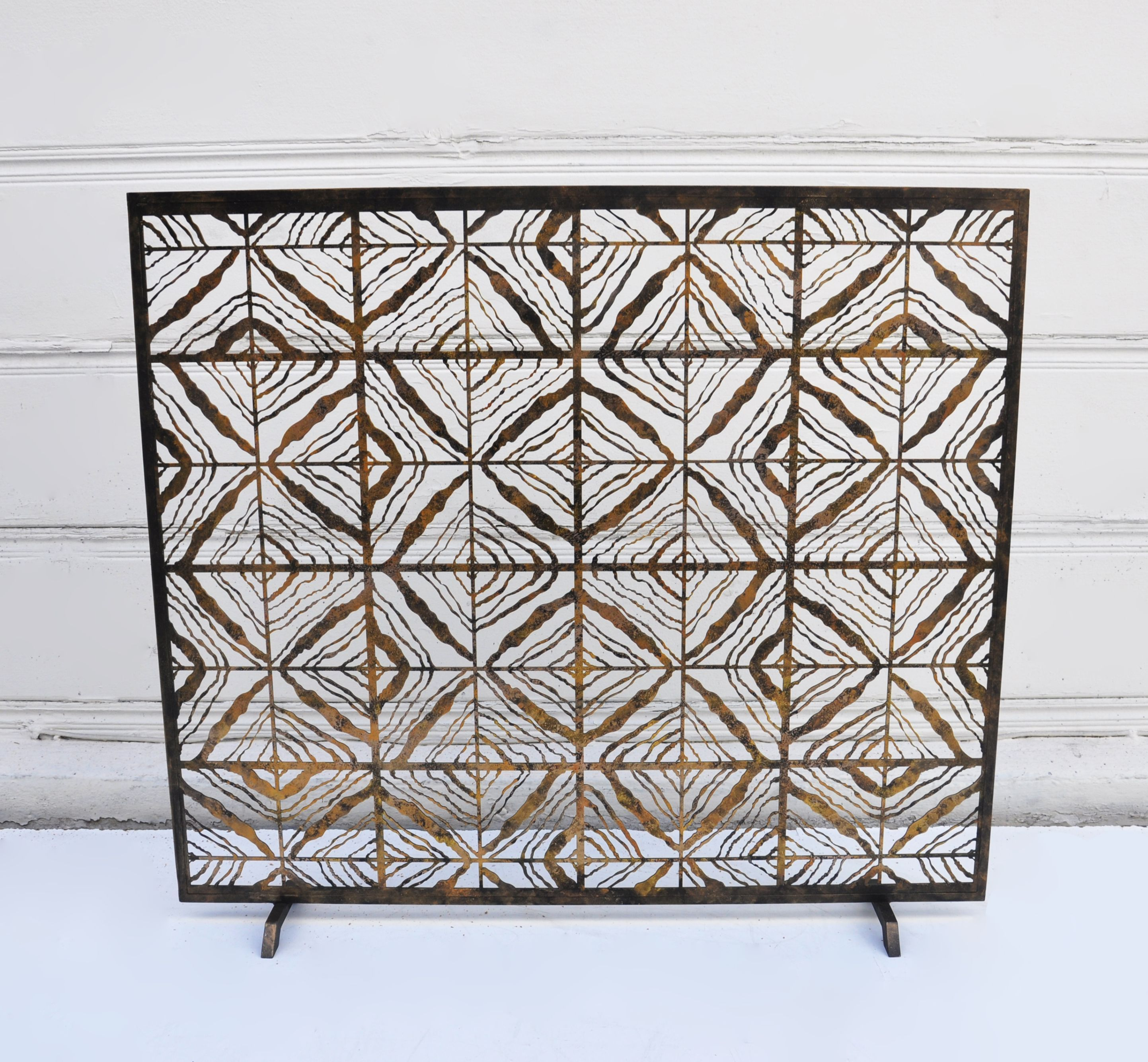 hand crafted geometric firescreen hand applied black and gilded gold
