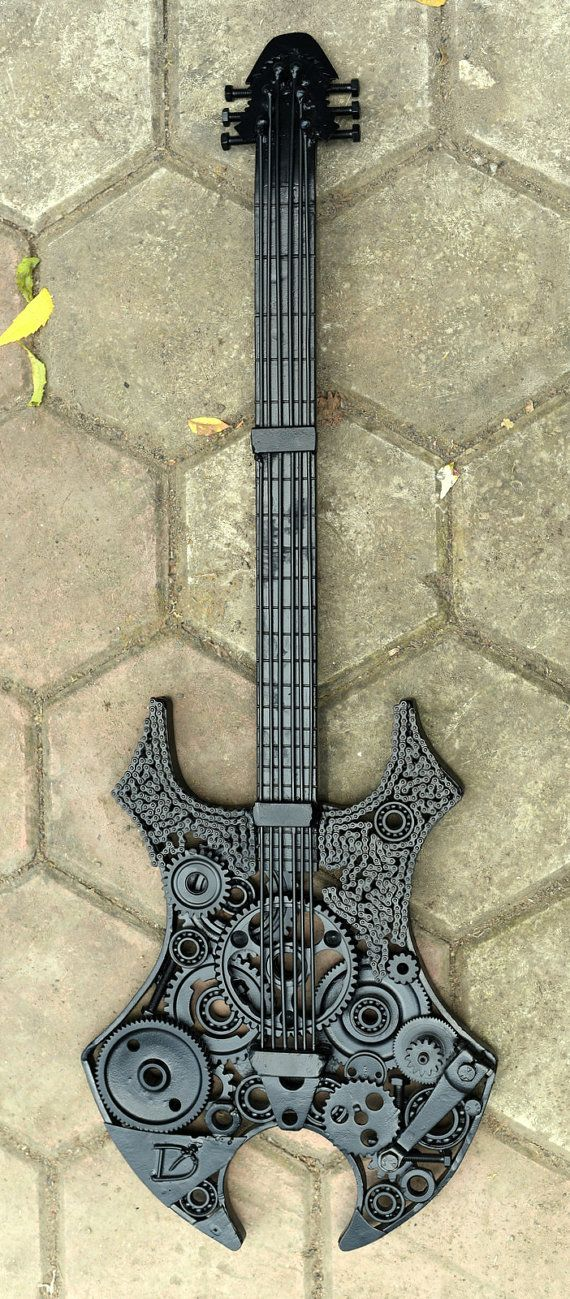Metal scrap virgo guitar sculpture