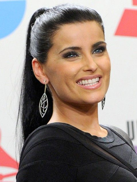 1826d2df2c Nelly Furtado s sleek and sexy ponytail lets her glossy pink lips and  smoldering eyes take center stage. File this under HOT.