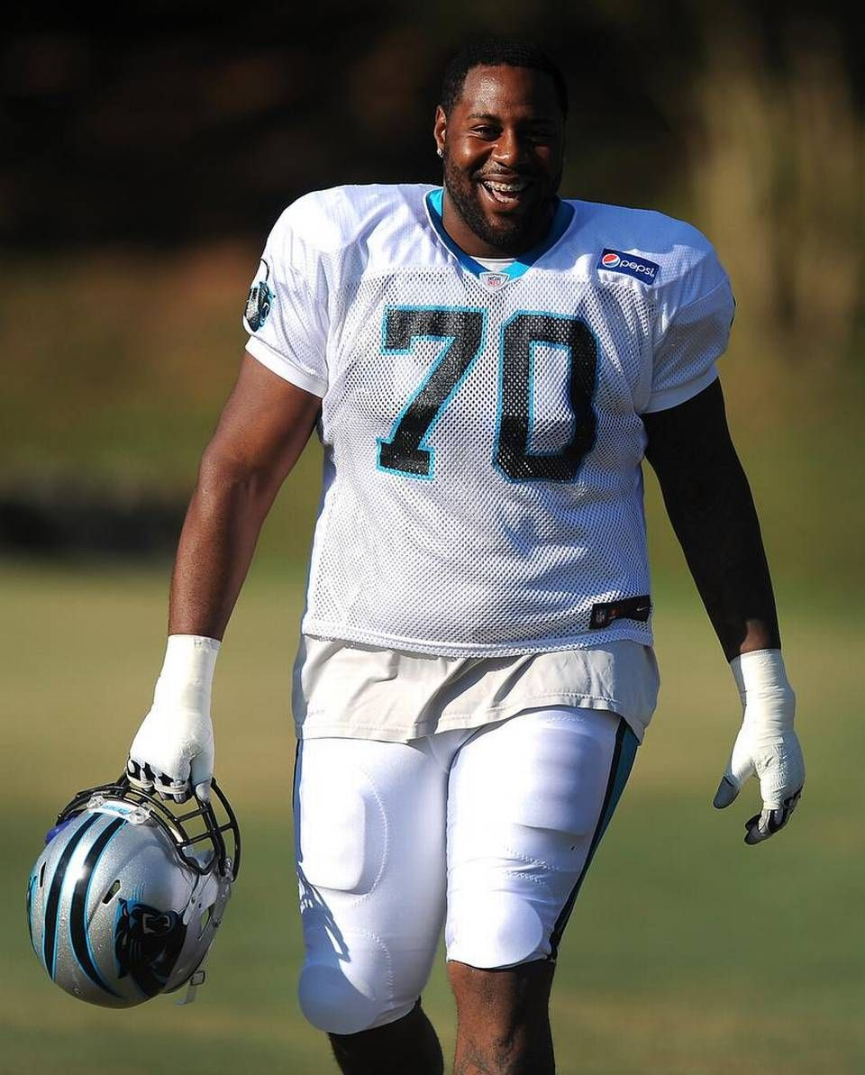 b36d3a603 Carolina Panthers guard Trai Turner smiles as he listens to the calls of  fans for autographs as he walks to practice on Sunday